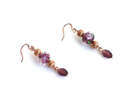 These earrings are for the romantic in all of us! The purple tones also add a regal touch.... I used pretty and dainty floral lamp work beads, shimmery crystals, and textured rose gold plated beads to create these beauties. They measure 1 1/2 inches from the base of the rose