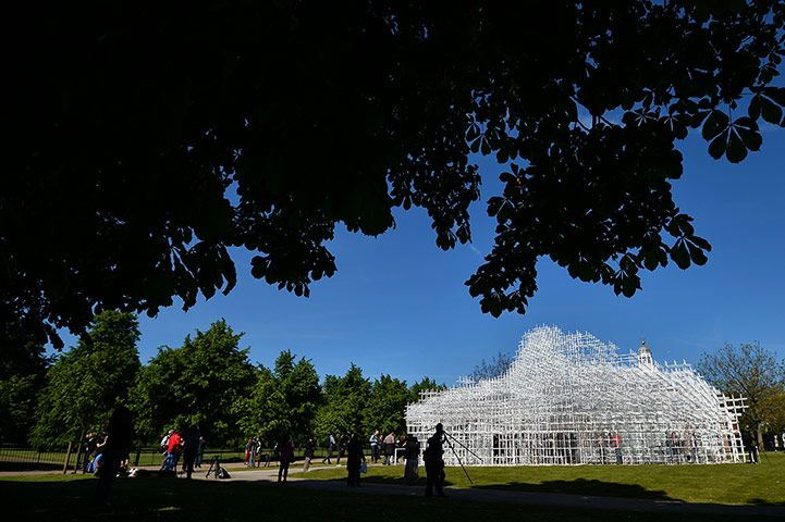 Serpentine pavilion: People take pictures of Sou Fujimotos pavilion. The Serpentine gallery roo