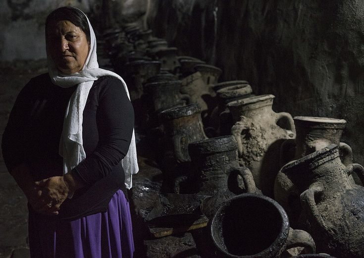 Eric Lafforgue, Yazidi Woman Standing In Front Of Olive Oil Jars, Temple City Of Lalesh, Kurdistan, Iraq