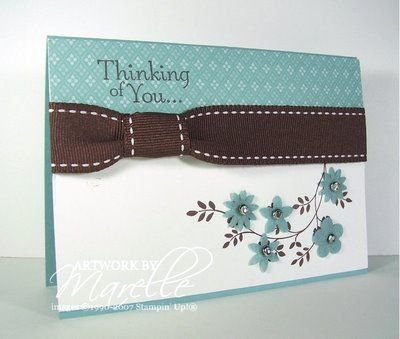 white, chocolate and blue ... luv the wide ribbon treatment with the band slightly pulling it in ... felt flowers on stamped branch ... lovely card ... Stampin' Up!