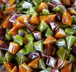 Dodol - Rice flour-based small glutinous sweets, sweetened with coconut sugar, moulded and colored. Often add fruit scent and taste such as durian.