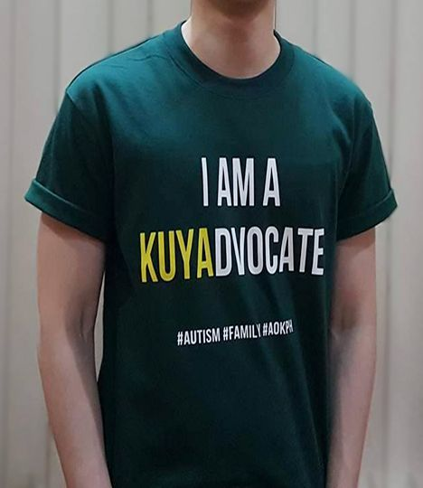 """These cotton crewneck shirts bear celebrate the unity of families who live and love with autism.  """"I am a KUYAdvocate."""" Brothers of persons with autism are often their """"partners in crime"""", their protectors against bullies and important advocates for genuine inclusion. #siblings."""