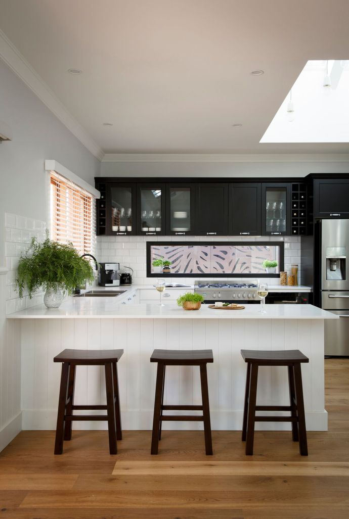 Reno Rumble 2016 Scott and Nadia Kitchen. Hamptons Style Kitchen in Dark Colourway with Glass window Splashback and subway tiles.