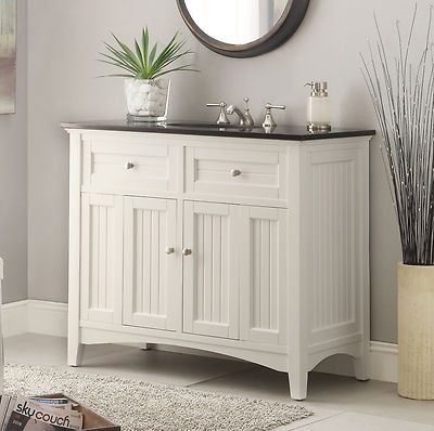 "Dimensions: 42 x 21 x 37""H. approx. The plantation-inspired look of this cottage-style sink vanity cabinet is a sophisticated piece. This clean lining bathroom vanity offers a look that will create a"