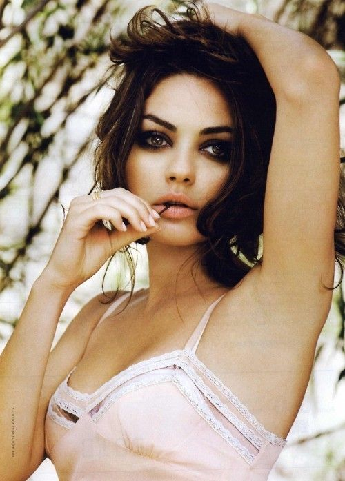 Mila Kunis.  I love love love light, romantic pinks with dark hair/eyes and makeup.