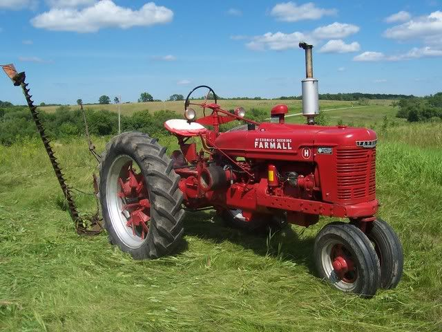 1943 Farmall H with IHC 25-V sickle bar mower...my grandfather still has one!