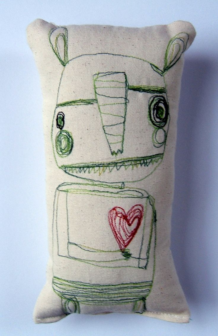 a wacky quirky fun embroidery pillow. Done also in soft muslin polyfil 4 x 8.5. In the darkness of the world I will always keep my heart lit with love  Lit those hearts with love always.