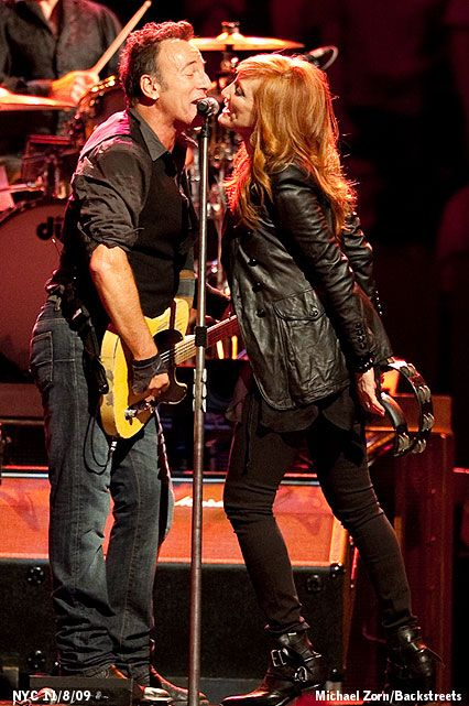 Bruce Springsteen and wife Patti Scialfa on stage.
