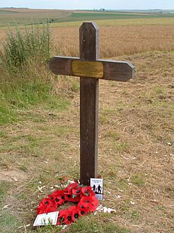 Cross marking the spot where the remains of Private George Nugent of the Northumberland Fusiliers were found in October 1998 on the old Somme 1916 battlefield . He had been killed on 1st July, the first day of the Battle of the Somme 1916. He had been recorded as missing in action. His body was found close to the mine crater blown on that day, known as Lochnagar Crater. He was reburied in the nearby Ovillers Military Cemetery on 1st July 2000.