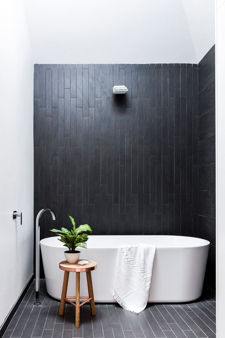 """A lightwell illuminates moody charcoal ceramics. """"At night, LED strip lighting makes the water from the rainshower glisten,"""" says Carlo. Forme bath, [Harvey Norman](http://www.harveynorman.com.au/?utm_campaign=supplier/