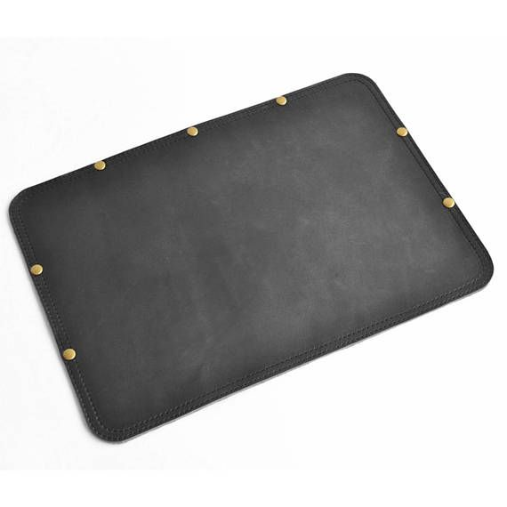 A leather desk pad is truly a luxurious accessory. Why not treat yourself to something that will dress up your desk? You carry a great leather bag, right? (If not, please check out our briefcases and satchels too!) We offer two sizes and three colors for our full grain, vegetable