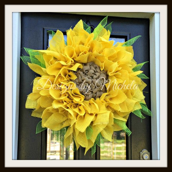 This Burlap Sunflower is made with 5 yards of yellow burlap cut in to individual petals. It is extra full and large to make the perfect statement on any door.