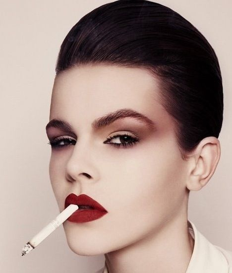 Brown Creamy Smokey Eyes, Matte Red Lips, and Cigarette. Editorial Makeup.