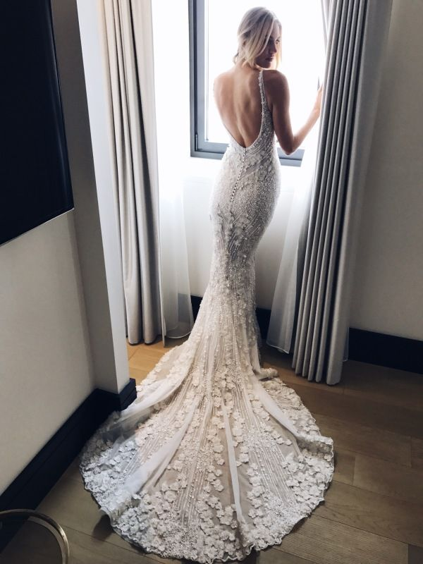 Elongated train wedding gown: http://www.stylemepretty.com/2016/10/16/pallas-couture-fall-2017-bridal-week-wedding-dresses/