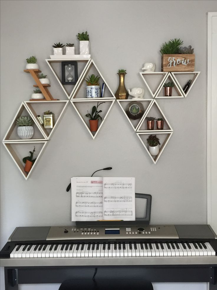 Living succulent wall with triangle shelves- wall color: valspar filtered shade, shelves- five below