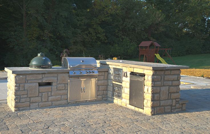 Outdoor Grill , work station area with small mini fridge.