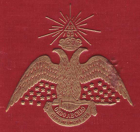 """Double headed eagle on Albert Pikes Freemasonry book """"Morals and Dogma"""" with Order Out of Chaos slogan."""