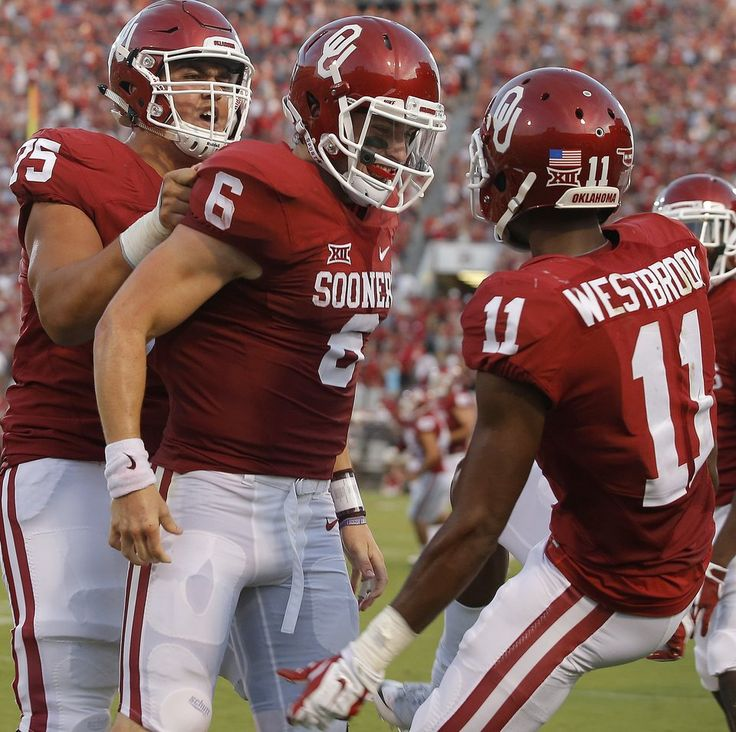 Oklahoma's Baker Mayfield (6) celebrates with Dede Westbrook (11) and Dru Samia (75) after a touchdown during a college football game between the University of Oklahoma Sooners (OU) and the Akron Zips at Gaylord Family-Oklahoma Memorial Stadium in Norman, Okla., Saturday, September 5, 2015. Photo by Bryan Terry, The Oklahoman