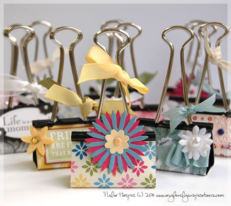 Cute - use Mod Podge to decorate boring binder clips with scrapbook paper & little flowers  I was thinking of making a storage unit connecting Clementine crates with binder clips but decided they wouldn't look good together--never thought of decorating them!