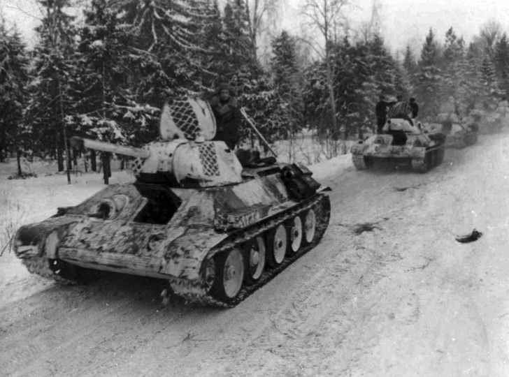 A Soviet convoy with T-34/76 obr. 1941 tanks with winter camo patterns.