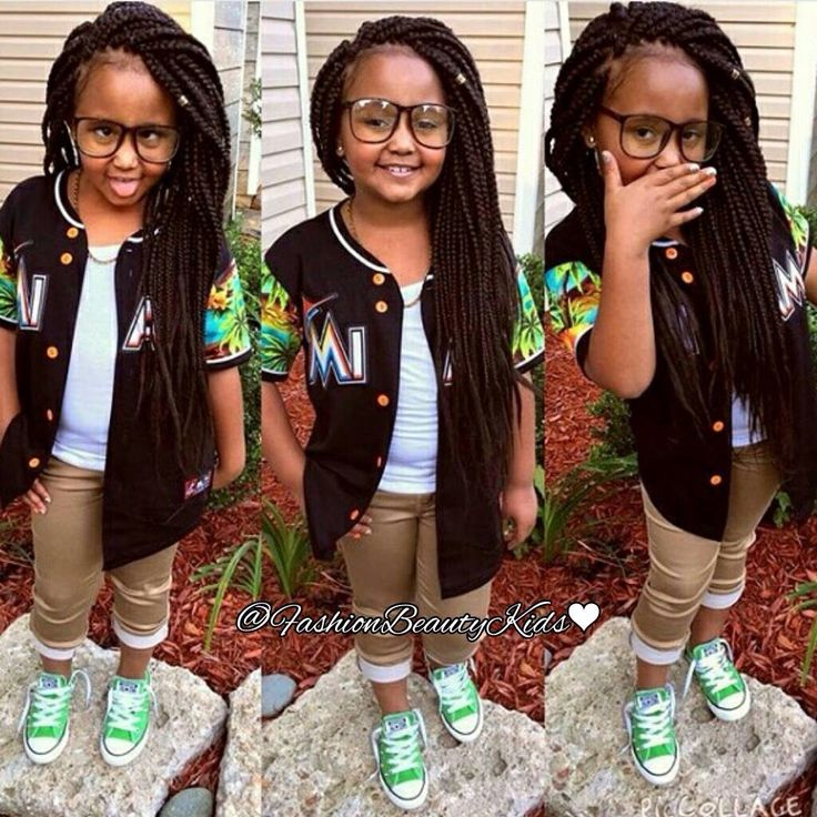 Little girl with box braids. Protective styling for kids
