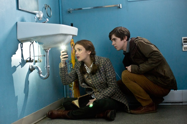 Ep. 3. What's Wrong with Norman (Bates Motel) Pic 10/14 - In the Motel, they discover a Chinese character scratched into the surface under the sink. Emma cant believe it. She was here, Norman! She was real! She takes a picture for further study. AETV.com