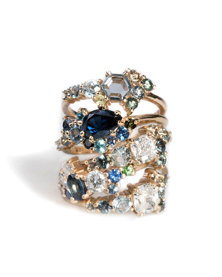 We can't even. This stack of custom cluster rings is unreal.  The customized versions of this wedding season's hottest ring shows how a great design can allow for endless variations to make stunning ethical, bespoke jewelry.