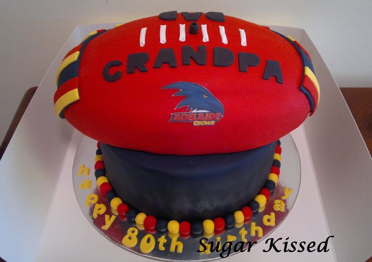 An Adelaide Crows football themed cake created by Shandi Sansom from Sugar Kissed. Featuring a printed afl logo. Please visit my facebook page to see more of my work: www.facebook.com/sugarkissedshandi