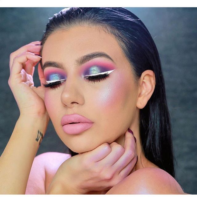 Pink and iridescent purple eyeshadow and white eyeliner for that pop pop