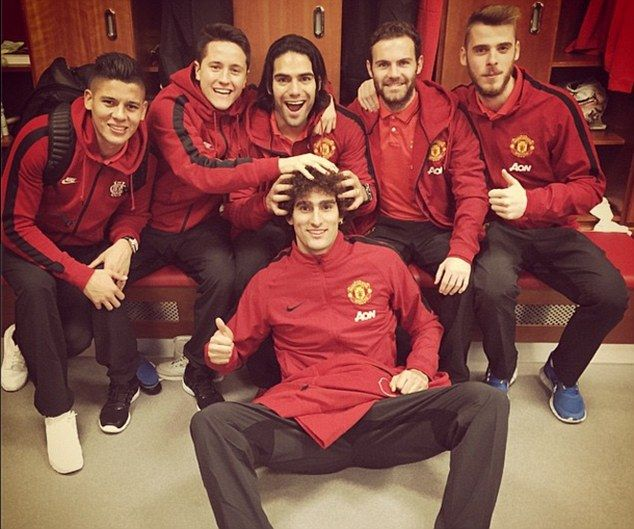 Team-mates Marcos Rojo, Ander Herrera, Radamel Falcao, Marouane Fellaini, Juan Mata and David de Gea