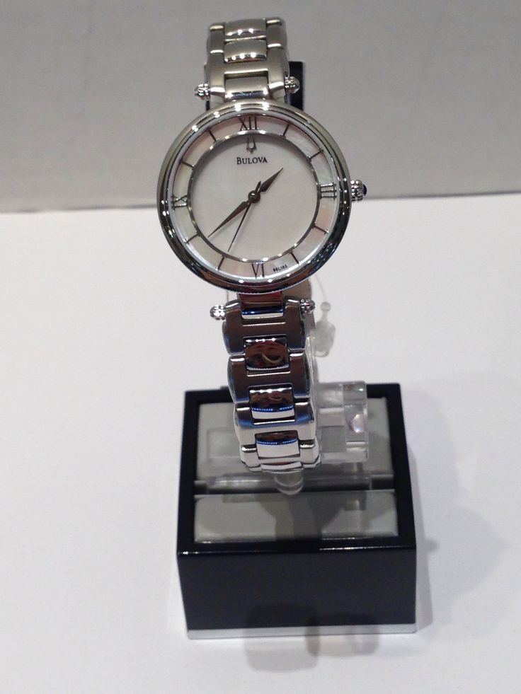 Ladies Bulova white with mother of pearl face