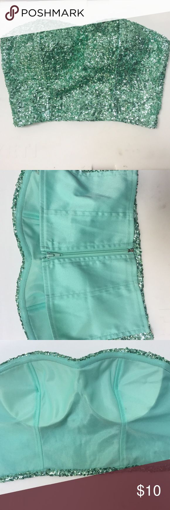 Charlotte Russe Sequin Crop Top Size Small Charlotte Russe Crop Top. Covered in Green sequins. Size Small. Had boning and cupping for support. Super cute and perfect for mermaid costume! Charlotte Russe Tops Crop Tops