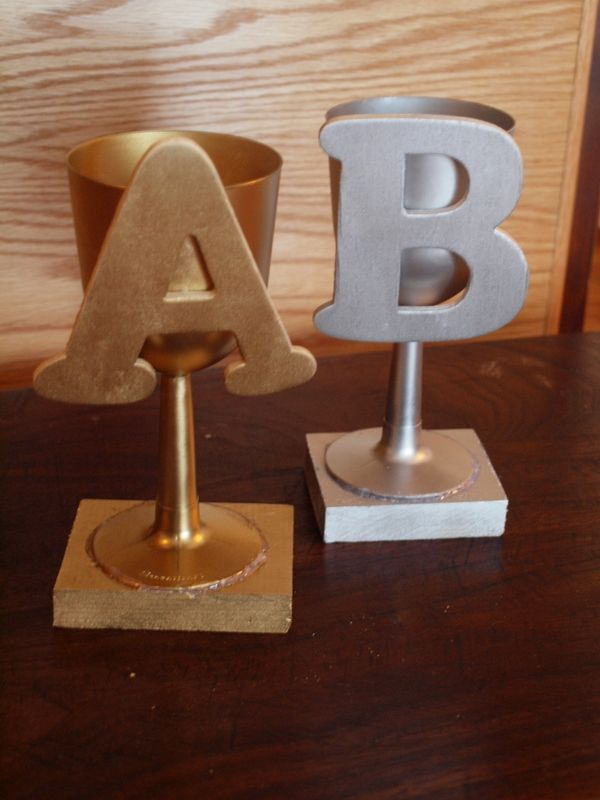 Spray painted DIY trophies for spelling bee.  Instead of 1st, 2nd, and 3rd place, it's A, B, and C place!