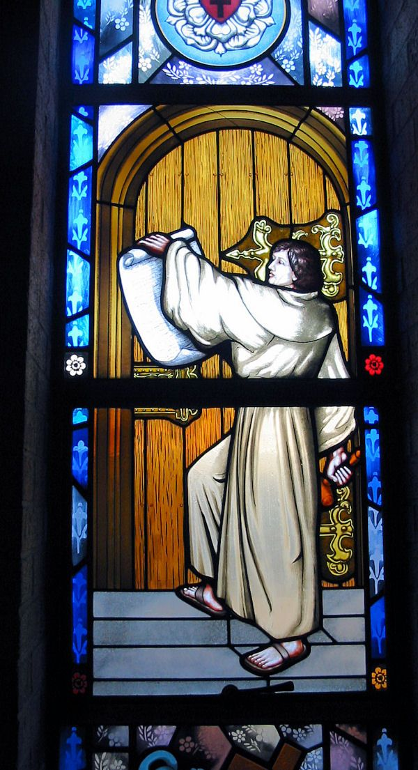 Martin Luther posting 95 Thesis, stained glass Central Lutheran Church, Spokane, Washington.