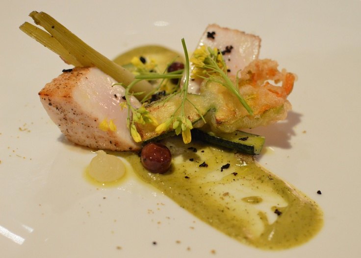 Loin of Swordfish cooked over coals w zucchini blossom, zucchini, fennel, black olive & yuzu