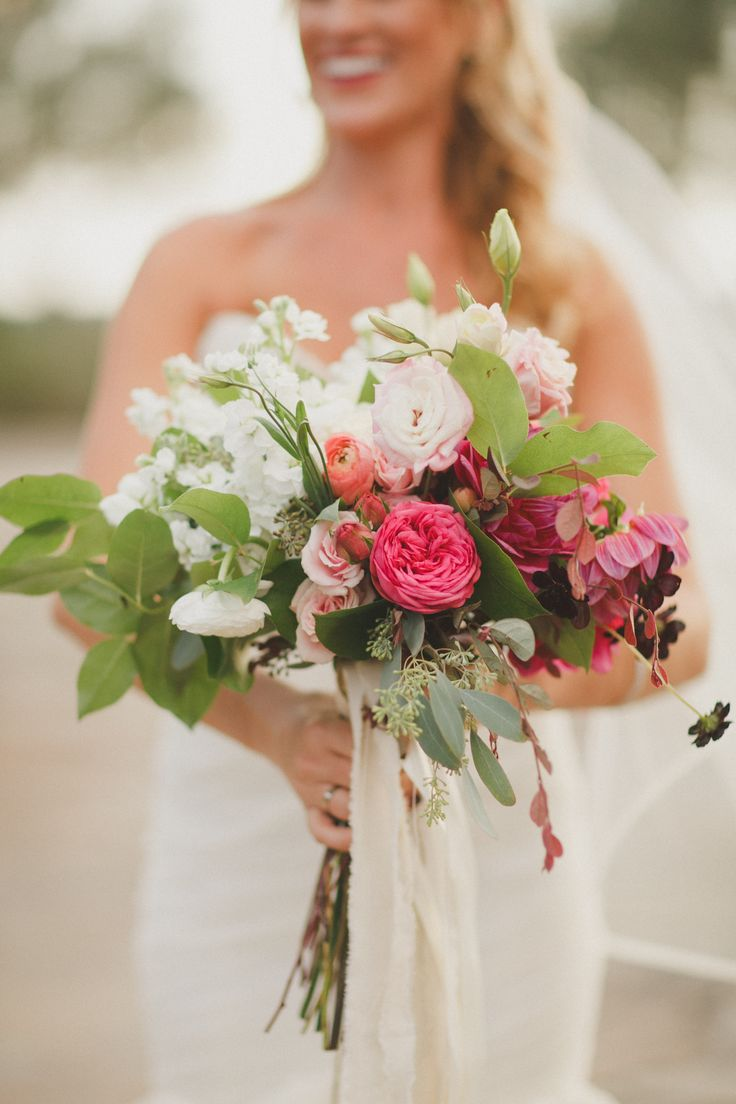 an ombre bridal bouquet of hot pink dahlia, hot pink piano roses, chocolate cosmos, pink spray roses, cream vendela roses, pink ranunculus, pink lisianthus, white stock, white ranunculus, seeded eucalyptus and lemon leaf hand tied with cream satin and muslin ribbon.