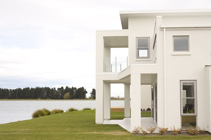 An abundant number of glass windows look out onto the lake
