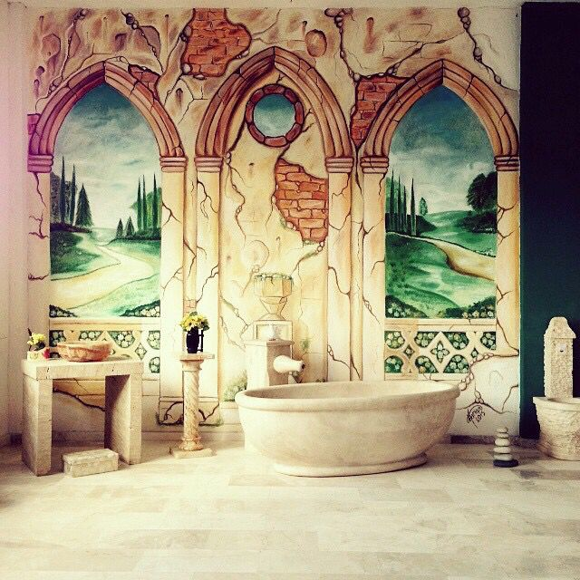 Mural painting by www.ramian.ro and natural stone bath with onix sink and travertine table from www.vinca.ro