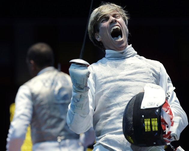 Peter Joppich of Germany, right, reacts after winning his match against James-Andrew Davis of Great Britain during men's individual foil fencing at the 2012 Summer Olympics, Tuesday, July 31, 2012, in London.(AP Photo/Dmitry Lovetsky)