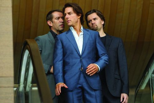 """Tom Cruise in Ghost Protocol sporting a custom made mohair """"shark-skin"""" suit designed by Michael Kaplan."""
