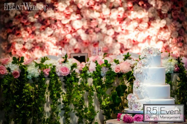 Flower wall, head table & cake with real roses and sugar flowers! Pink Secret Garden Wedding, featured on the @elegantwedmag blog! Full service event decor and Flowers by R5 Event Design