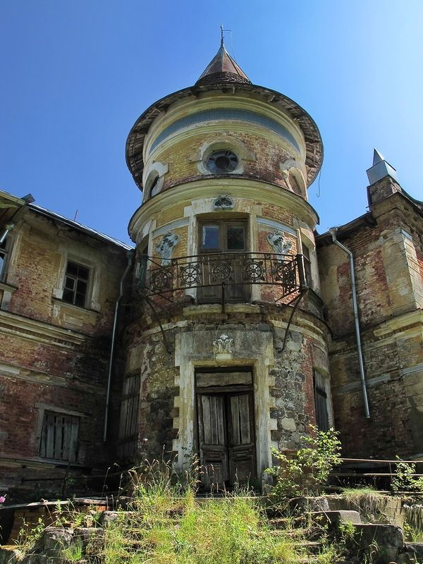 Abandoned house built in the period of late eclecticism in a romantic style in the Tver region, Russia.
