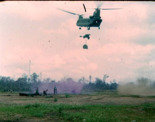 US Army Boeing CH-47 Chinook brings in an artillery piece, Vietnam 1967.