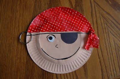 """I HEART CRAFTY THINGS: Story Time Tuesday w/ Paper Plate Pirate Craft Materials you will need: -2 paper plates (one is just for tracing) -skin tone color paint -paint brush -12"""" x 12"""" square of pirate-inspired fabric -hot glue gun -black sheet of construction paper -one large wiggly eye -black marker -hole punch -metal binder ring"""
