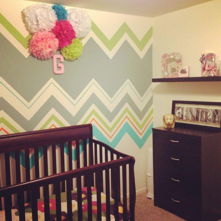 Chevron baby girl room with tissue paper flower balls
