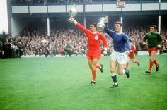 Everton 0 Liverpool 1 in Aug 1966 at Goodison Park. The Div 1 trophy and FA Cup are shown around by captains Ron Yeats and Brian Labone before the Charity Shield.