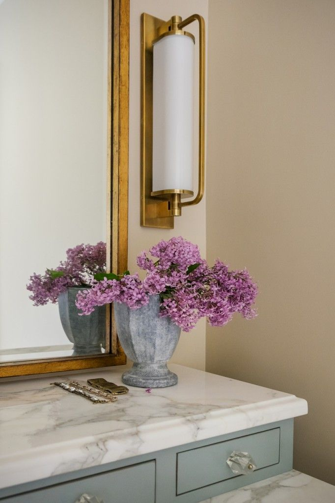 alice lane home collection | master bath, vanity, gold sconce, gold mirror, carrera marble, glass knobs
