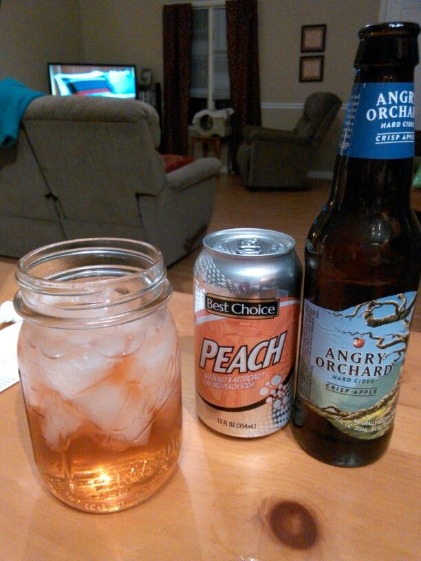 An angry peach.  Half àngry orchard crisp apple and half peach flavored soda, preferably peach nehi poured on top over crushed ice.  Simple and the best tasting homemade wine cooler