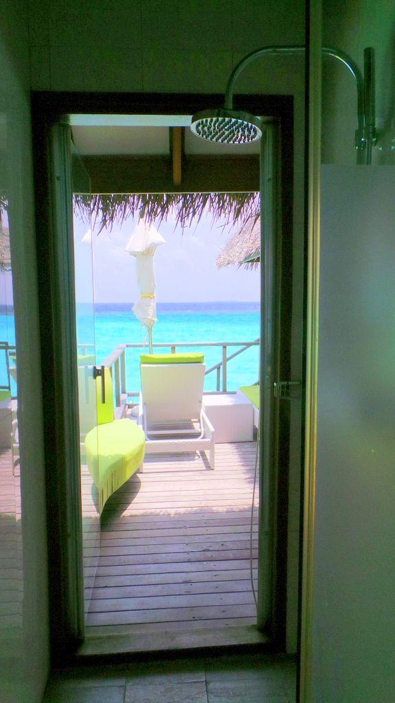 shower overlooking the ocean at Maafushivaru Maldives' Water Villa