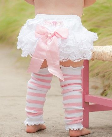 Your little one will feel like a royal princess in this lace-decorated, ruffled bloomer. Topped with a preciously pink bow, she will be the belle of her ball.